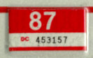 1986 (expires 1987) sticker, white on red
